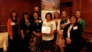 Representatives of the Kaneland School District and KAI attend the INSPRA Communication Contest and Golden Achievement Awards Luncheon on September 18, 2015. Pictured from left: Bonnie Whildin, Laura McPhee, Diane McFarlin, Dr. Todd Leden (behind), Maria Dripps-Paulson, Heidi Gilkey, Emily VanDelinder-Birchfield, Dr. Julie-Ann Fuchs, and Deanna Cates
